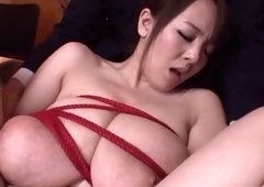 MILF from Japan with huge tits gets fondled and fingered