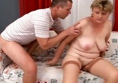Ugly fair haired granny got her hairy cum-hole screwed in sideways pose