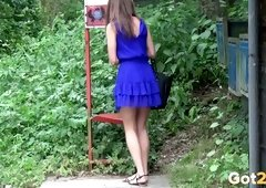 Darksome haired slim beauty in raunchy blue dress loves pissing on the bus stop